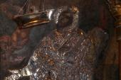 013. Роспись святителя Спиридона на стене украшена серебряным окладом
